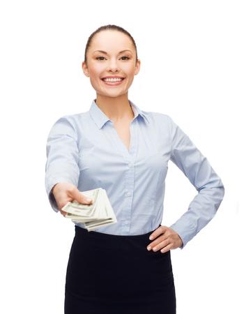 cash money: negocios y dinero concepto - joven empresaria con el dinero en efectivo en d�lares