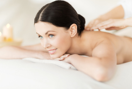 picture of woman in spa salon getting massage photo