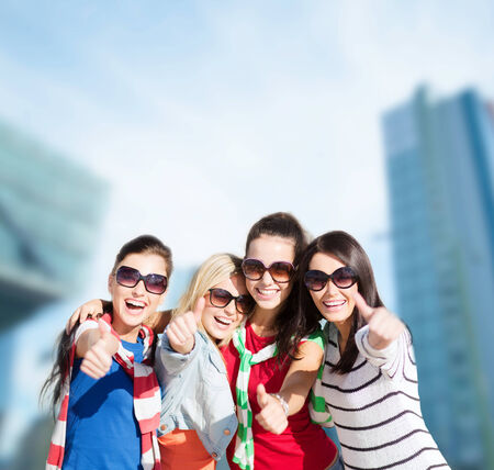 beautiful teenage girls or young women showing thumbs up photo