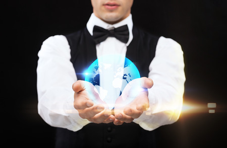 casino dealer holding globe on palms of his hands photo