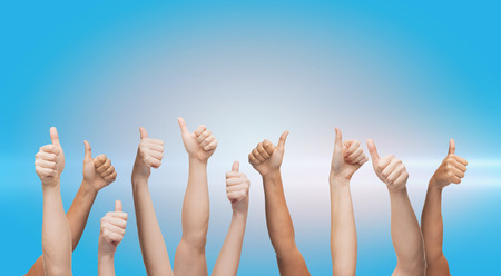 human hands showing thumbs up Stock Photo