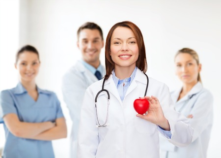 healthcare and medicine concept - smiling female doctor with heart and stethoscope Stock Photo - 26342298
