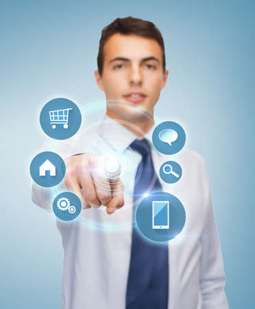 friendly young businessman pointing finger to virtual screen photo
