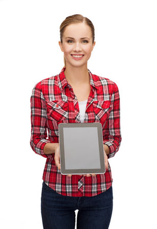 smiling girl with tablet pc computer with blank screen photo