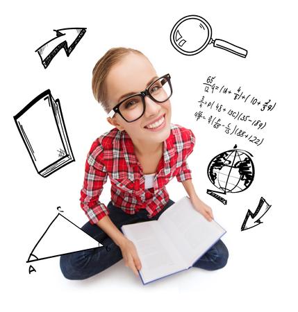 smiling teenage girl in black eyeglasses reading book photo