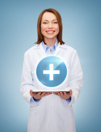 smiling female doctor and tablet pc computer photo