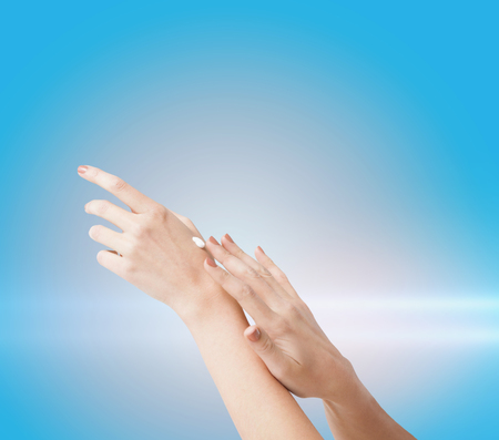 handcare: body parts, cosmetics and spa concept - close up of female soft skin hands with creme Stock Photo