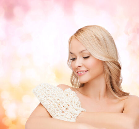 scincare: smiling woman with exfoliation glove