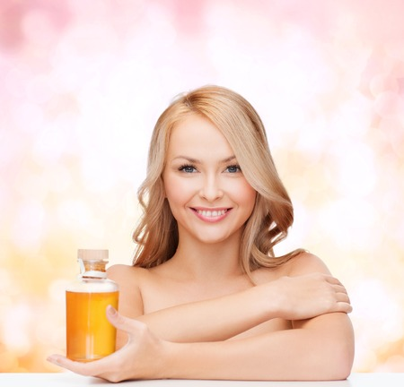 happy woman with oil bottle photo
