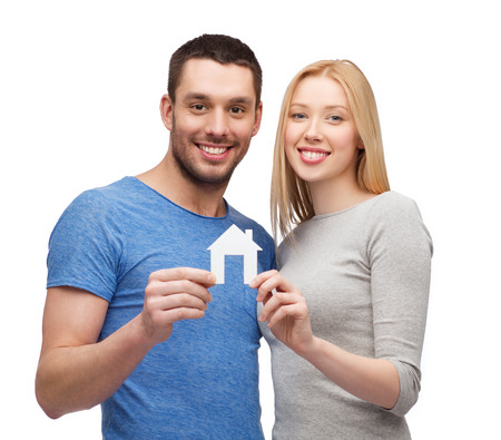costruction: smiling couple holding white paper house Stock Photo