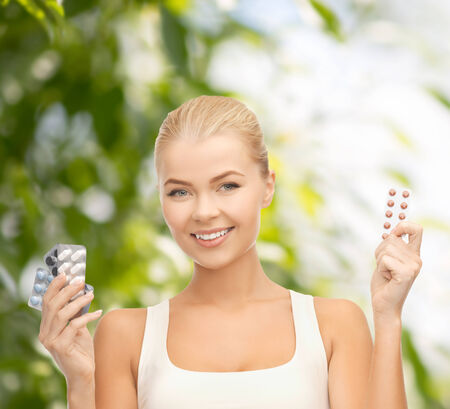 young woman with variety of pills