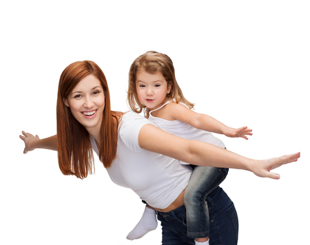 piggy back: childhood and parenting concept - happy mother and child doing piggy back