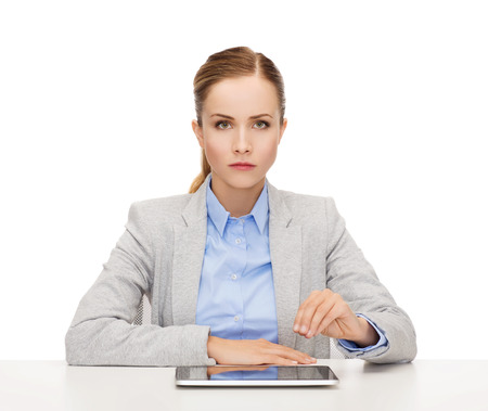 business, technology, internet and office concept - upset businesswoman with tablet pc computer holding something imaginary photo