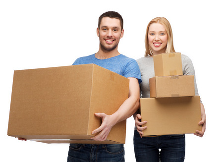 package shipment: smiling couple holding cardboard boxes Stock Photo