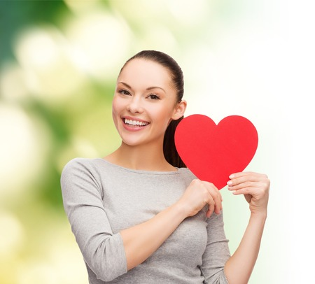 smiling asian woman with red heart photo