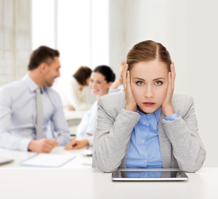 business, technology, internet and office concept - stressed businesswoman with tablet pc computer Stock Photo
