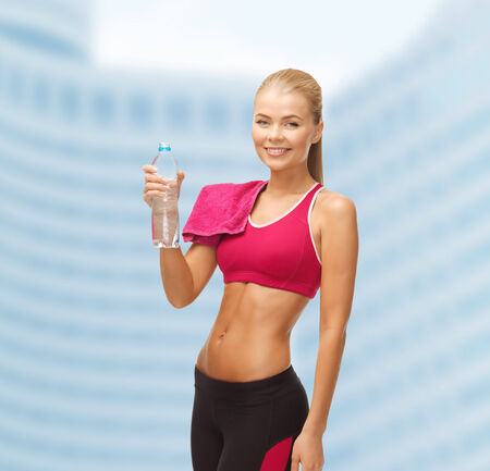 athletic wear: sporty woman with bottle of water and towel