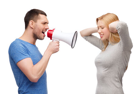 couple, family and relationship problems concept - boyfriend screaming though megaphone at his girlfriend photo