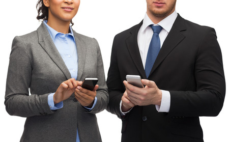 businessman and businesswoman with smartphones photo