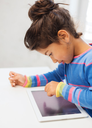 education technology: education, technology and internet concept - little girl with tablet pc Stock Photo