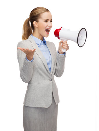 business, communication and office concept - smiling businesswoman with megaphone photo