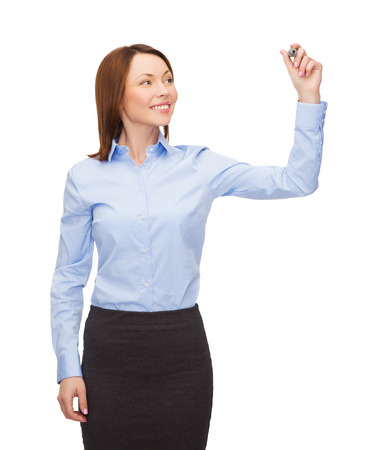 office, business and new technology concept - smiling businesswoman writing something in the air with marker Stock Photo - 26348812