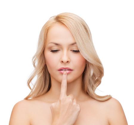 asian model: beautiful woman touching her lips