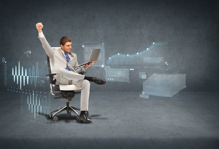 business, internet and technology concept - young businessman sitting in chair with laptop with virtual screens photo