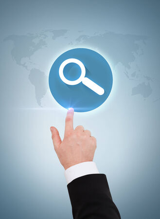 business and advertisement concept - close up of businessman pointing to magnifying glass photo