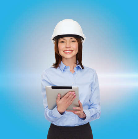 building, developing, consrtuction and architecture concept - friendly young smiling businesswoman in white helmet photo