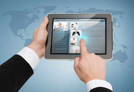 business, internet and technology concept - close up of man hands touching tablet pc Stock Photo