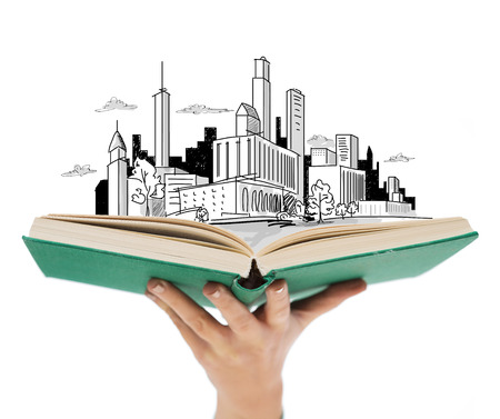architectural studies: education and book concept - close up of woman hand holding open green book with city sketch Stock Photo