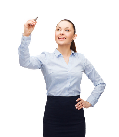 office, business and new technology concept - smiling businesswoman writing something in the air with marker Stock Photo - 26353358