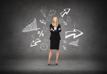 business, communication and office concept - friendly young smiling businesswoman with different doodle on the back photo