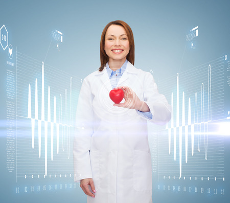 healthcare and medicine concept - smiling female doctor with heart photo