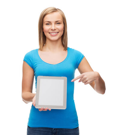 technology, internet, advertisement and people concept - smiling girl with tablet pc computer with blank scneen photo