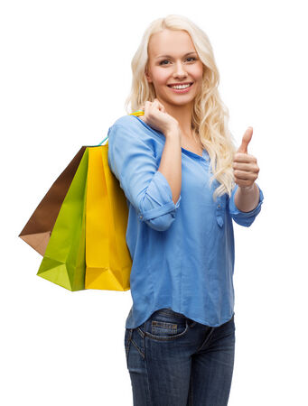 retail, gesture and sale concept - smiling woman with many shopping bags showing thumbs up Stock Photo - 26353611