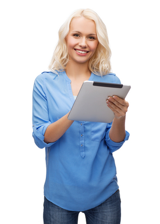 technology, internet and people concept - smiling girl with tablet pc computer photo
