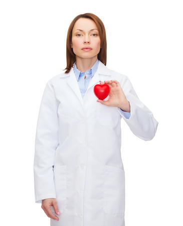 healthcare and medicine concept - smiling female doctor with heart Stock Photo - 26353651