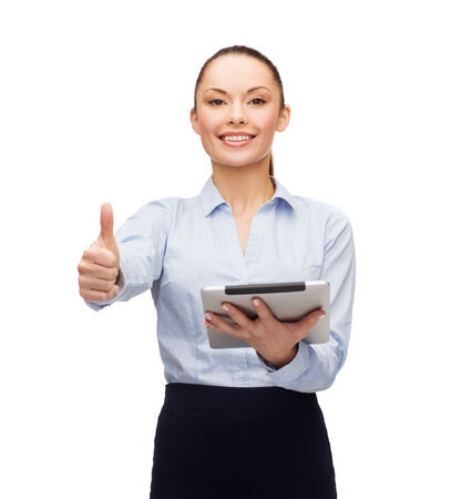 business, gesture, internet and technology concept - smiling woman looking at tablet pc computer showing thumbs up photo