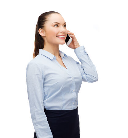 business, technology and education concept - friendly young smiling businesswoman with smartphone photo