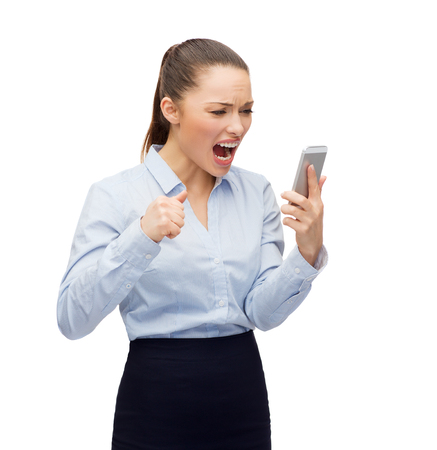 business, technology and education concept - screaming businesswoman with smartphone photo