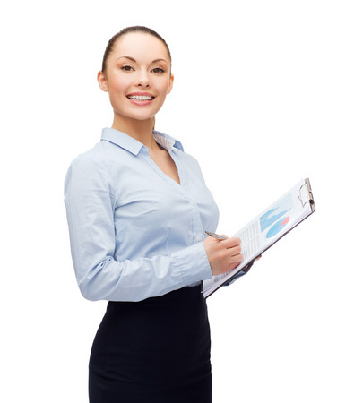 business and education concept - friendly young smiling businesswoman with clipboard and pen Stock Photo - 26353671
