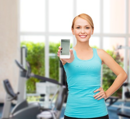 sporty woman with blank smartphone screen photo