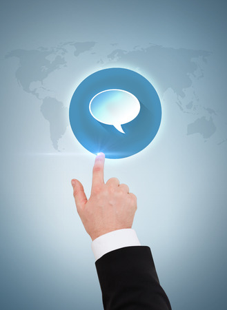 business and advertisement concept - close up of businessman pointing to text bubble photo
