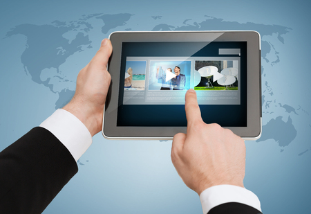 conputer: business, internet and technology concept - close up of man hands touching tablet pc Stock Photo
