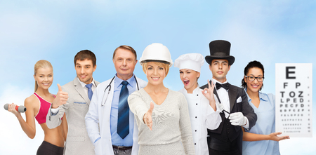 professions and people concept - group of people including businessman, cook, doctor, architect, nurse, magician and personal trainer photo