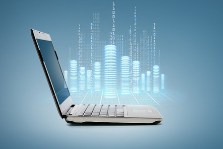 cryptography: technology and advertisement concept - laptop computer with digital coins and data Stock Photo