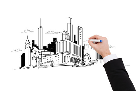 business and architecture concept - close up of businessman drawing city sketch photo