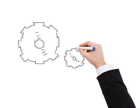 business and development concept - close up of businessman drawing cogwheel photo